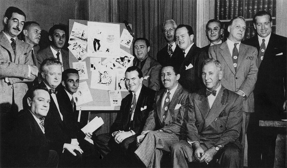 Mike Berry, Stan McGovern, Mel Casson, Gus Edson, Hal Foster, Alex Raymond, Al Carreno, Russell Patterson, Bob Dunn, Willard Mullin, Ernie Bushmiller, Alfred Andriola, Milton Caniff, Gregory D'Alessio and Rube Goldberg in 1949.
