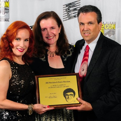 Kayre Morrison and Bill Morrison proudly display their Bob Clampett Humanitarian Award, presented at the Will Eisner Comic Industry Awards by Ruth Clampett (center).