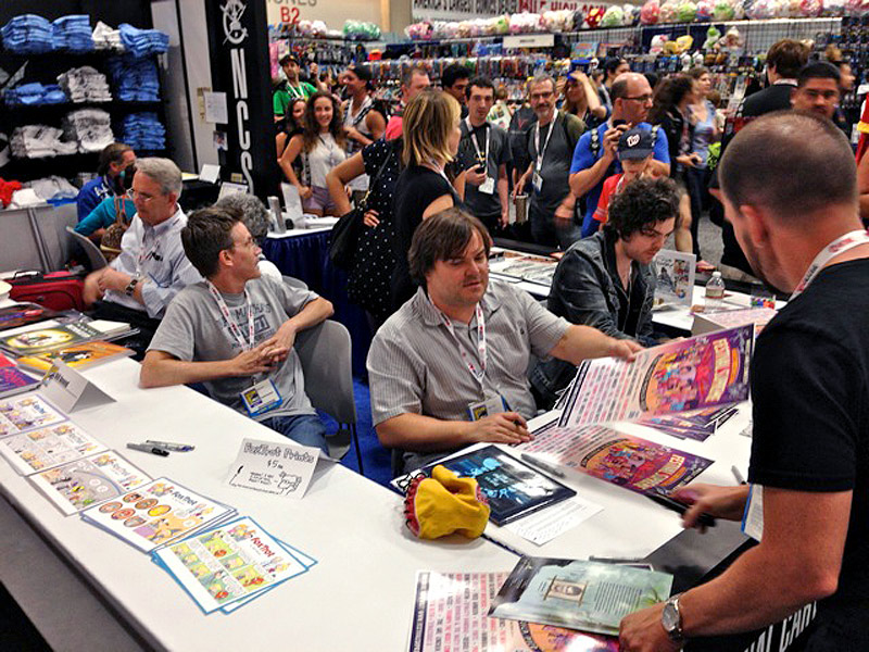 (L-R) Brooke McEldowney, Bill Amend, Jack Black and Luke McGarry signing at Comic-Con 2013.