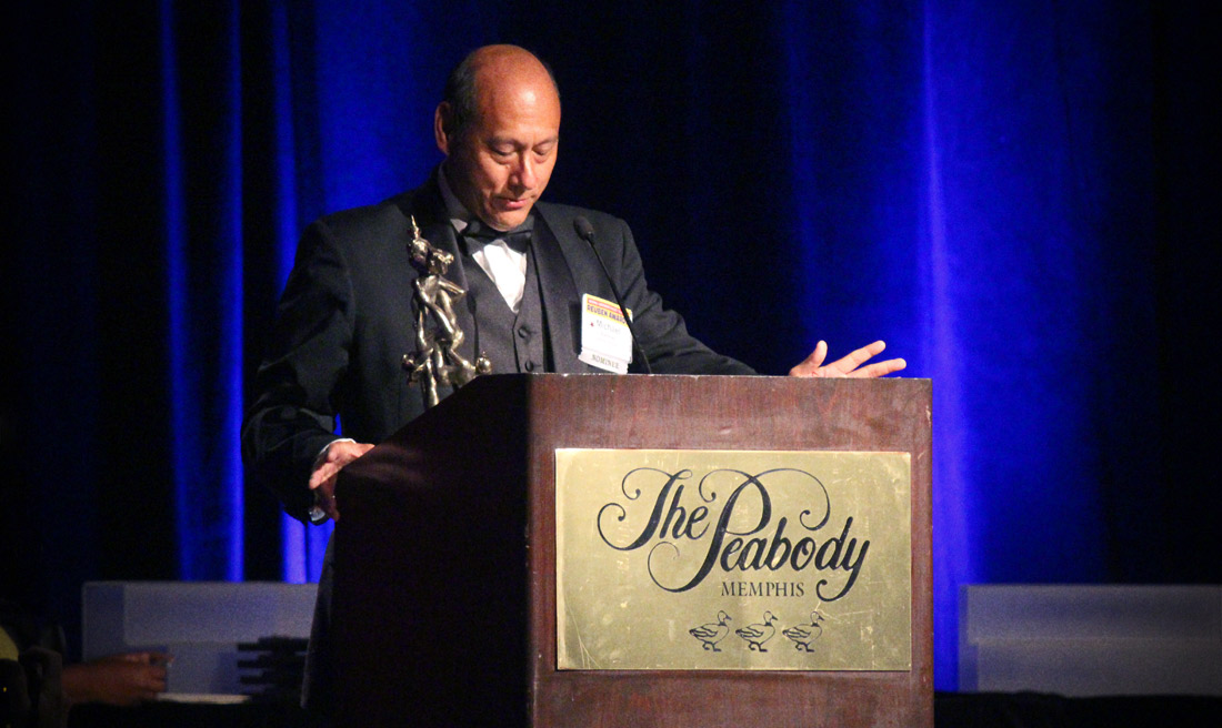 Michael Ramirez accepts the Reuben Award for Outstanding Cartoonist of the Year. Photo by Chad Frye